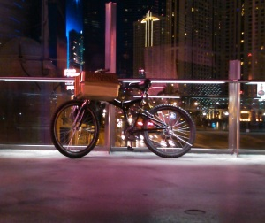 My folding mountain bike with PussPussPuss's golden pet carrier on a bridge near the Aria at the Vegas Strip